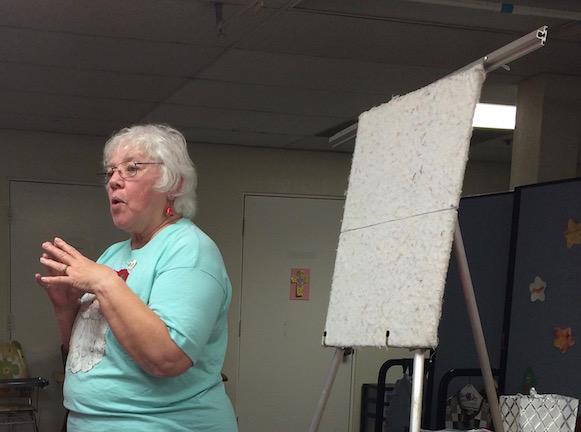 Pat is demonstrating the Tetris block plan.