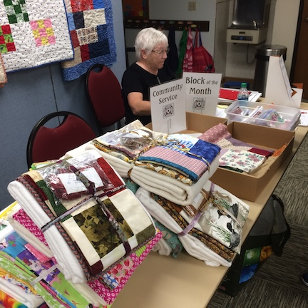 Community service has packets laid out for quilting and binding.