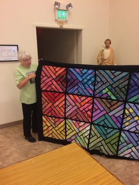 Lois Ann's magical finished quilt... looked over by Jesus.